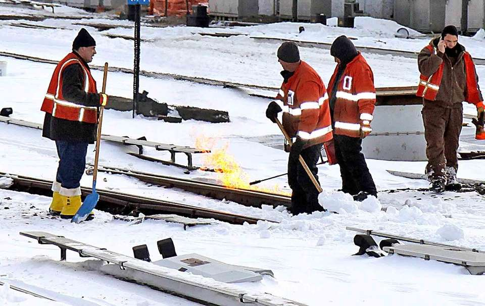 LIRR workers use fire to melt ice and