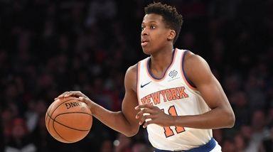 Knicks guard Frank Ntilikina dribbles the ball upcourt