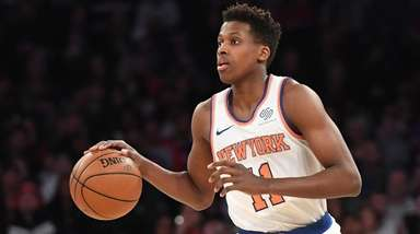 Knicks guard Frank Ntilikina dribbles the ball upcourt