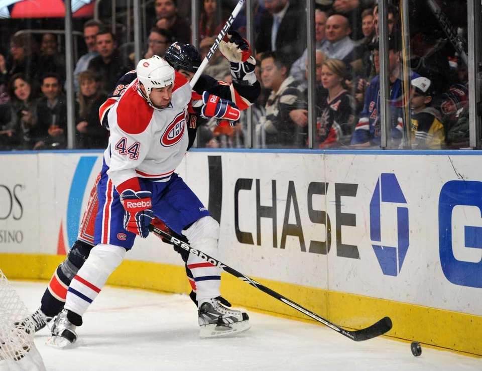 Montreal Canadiens defenseman Roman Hamrlik (44) holds off