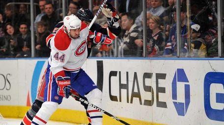 Montreal Canadiens defenseman Roman Hamrlik (44) holds off