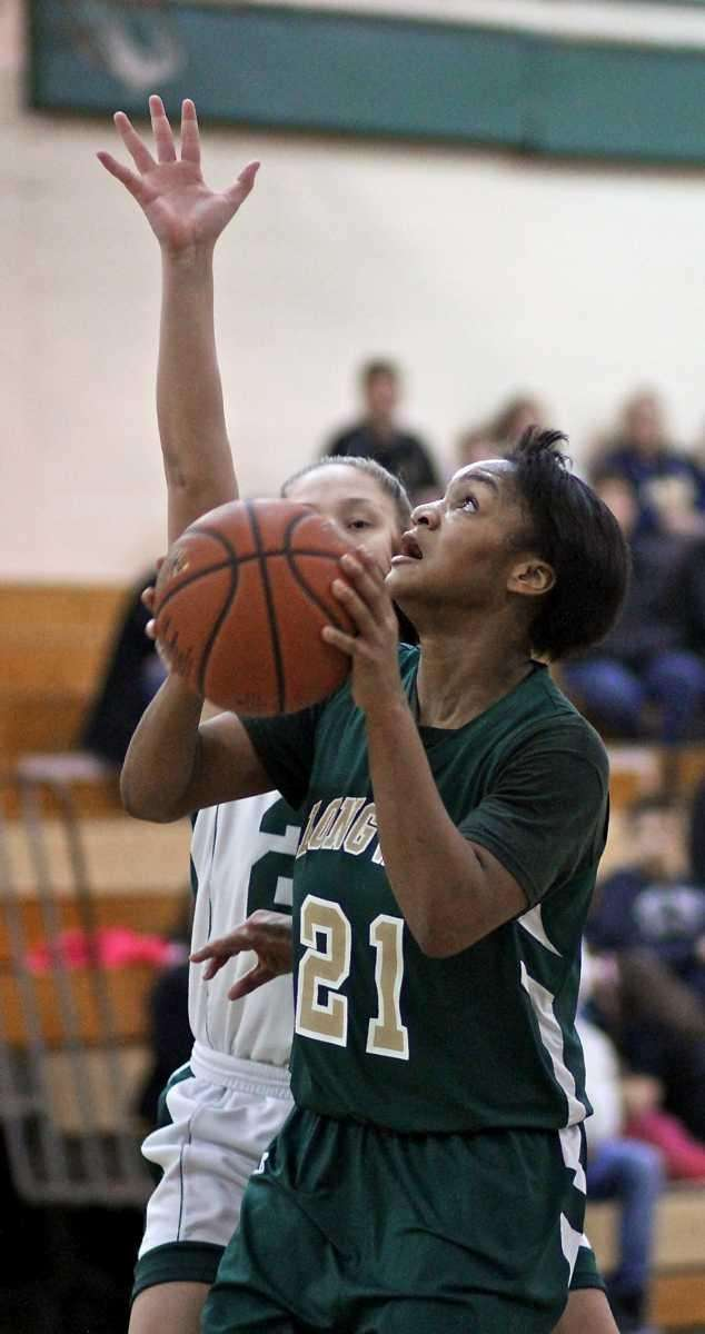 Longwood forward Asja Mayo #21 puts up the