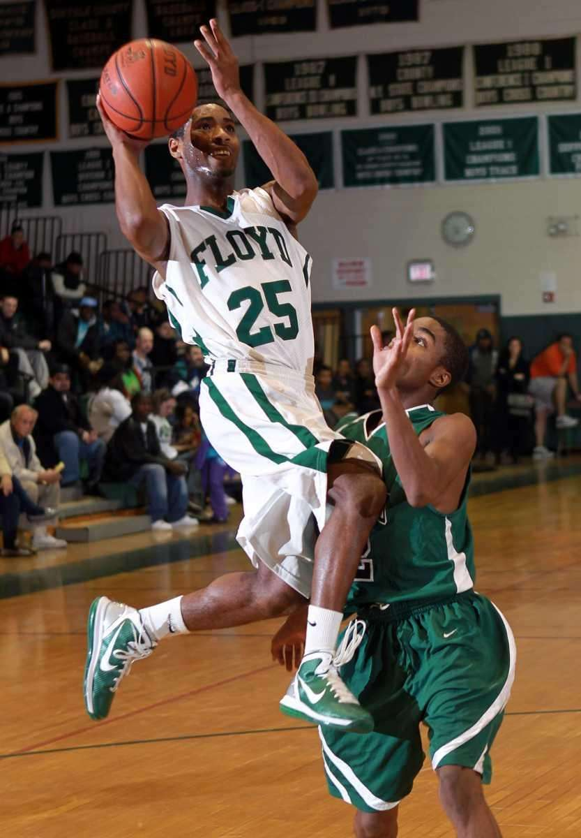 Floyd's Shabazz Thompkins (25) flies to the hoop