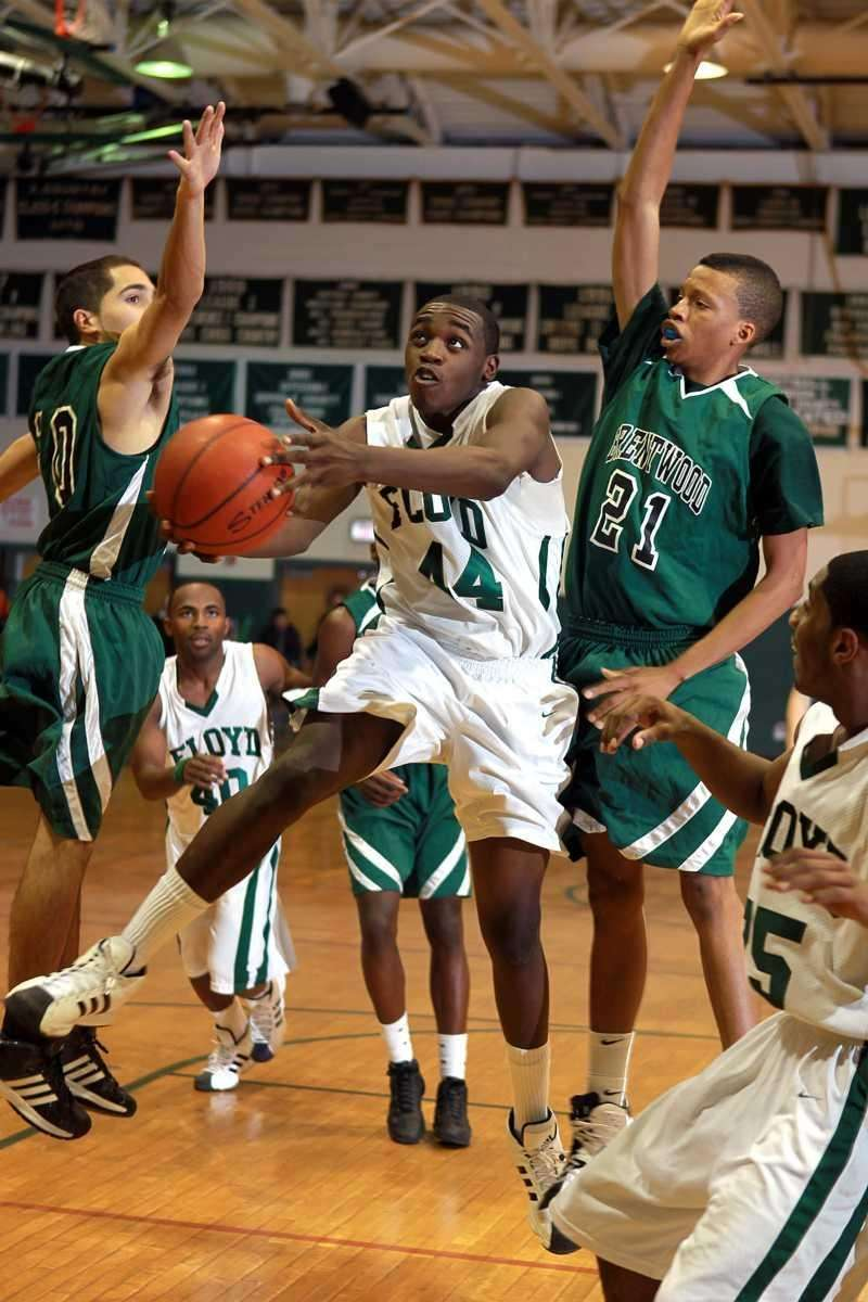 Floyd's Anthony White (44) with the scoop layup