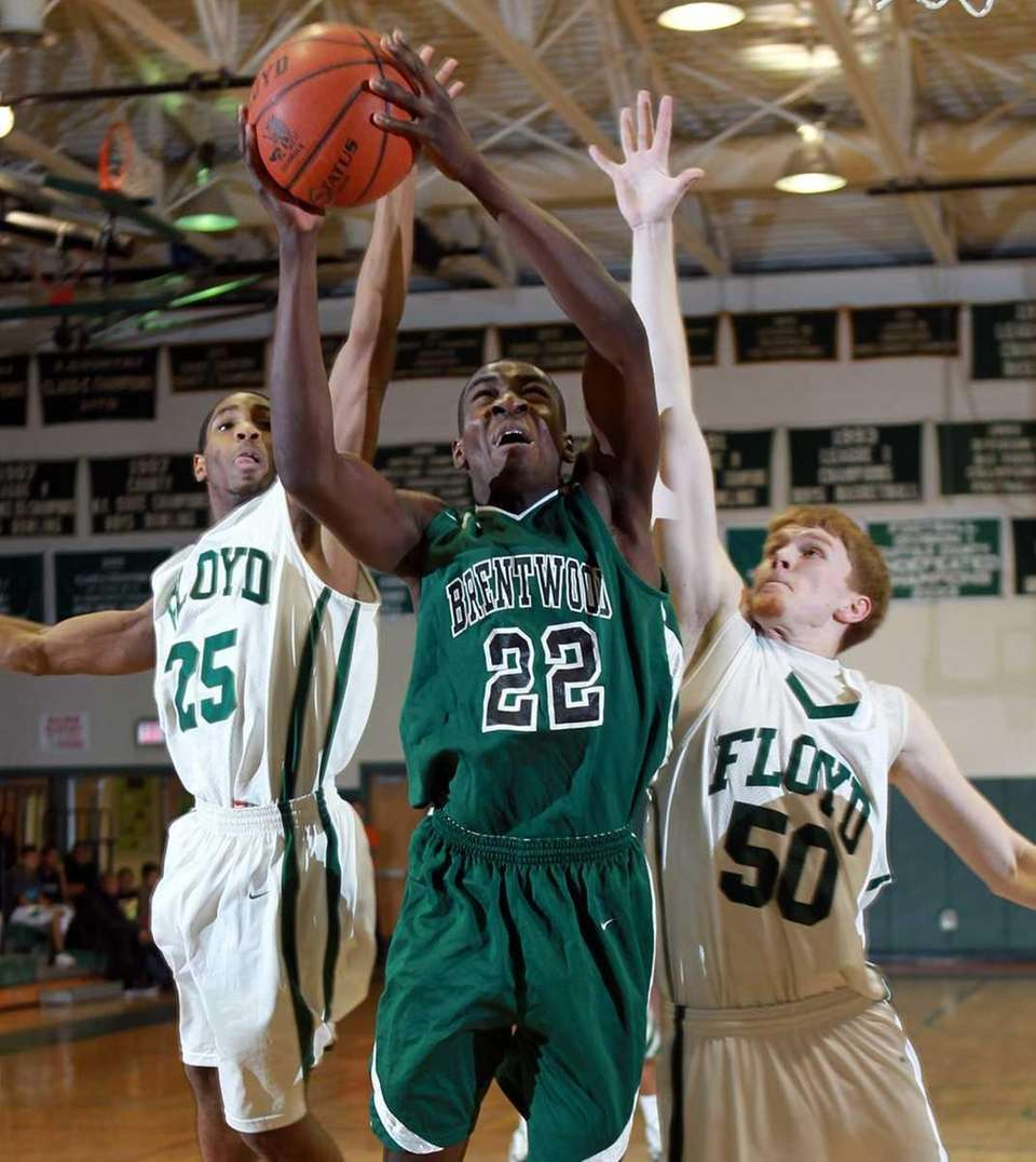 Brentwood's Fiyi Ojugbele (22) drives between Floyd's Shabazz
