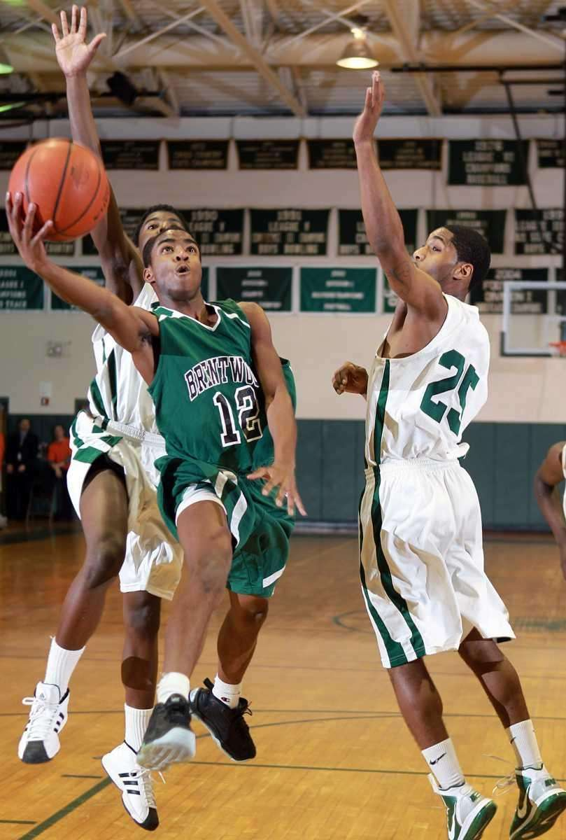 Brentwood's Sylvester Lubin (12) with the scoop layup