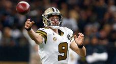 Saints quarterback Drew Brees  passes against the