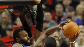 New York Knicks center Ronny Turiaf, left, defends