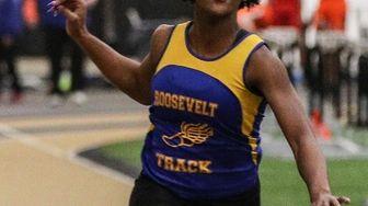 Beyona Monroe of Roosevelt crosses the finish line