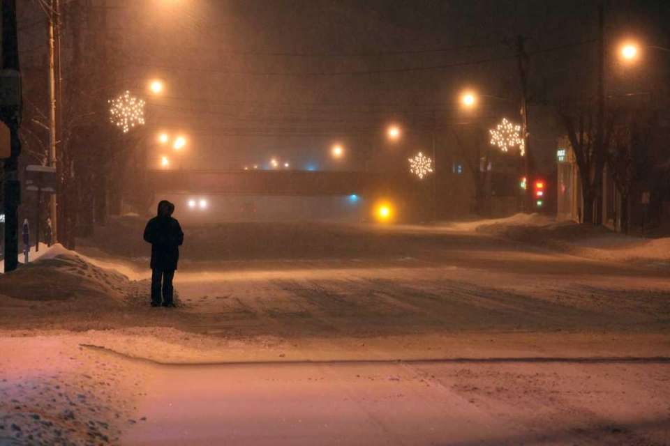 A pedestrian on a snow-covered Jericho Turnpike in