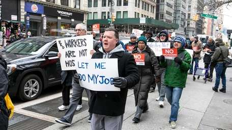 Federal workers and their supporters protest the government