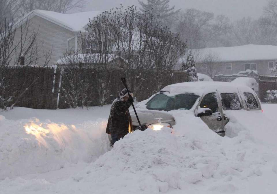 Fred Fucaloro, of Ronkonkoma, digs out his car