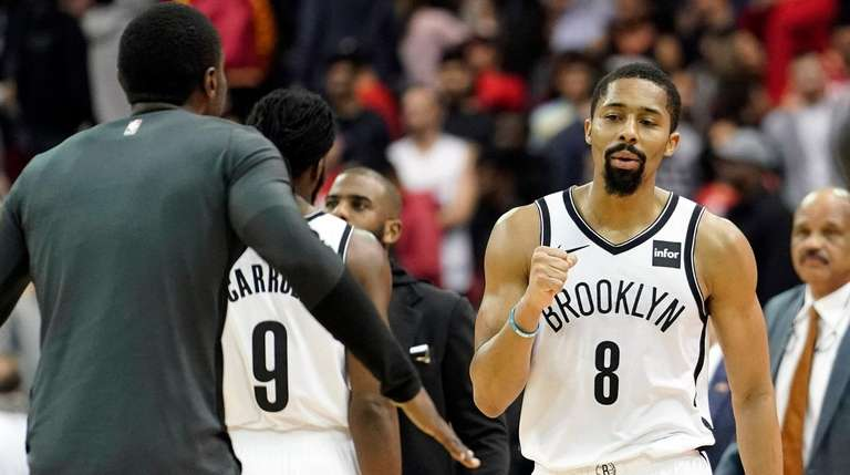 The Nets' Spencer Dinwiddie celebrates with teammates after