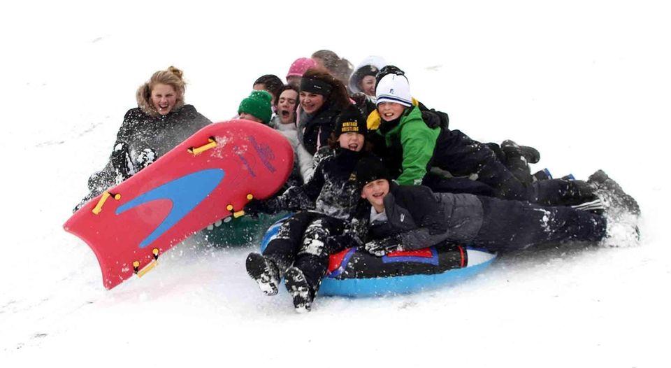 Sledders take advantage of the snow in Cedar