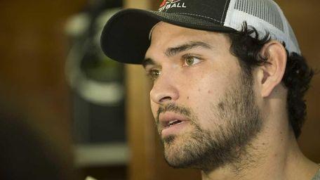 New York Jets quarterback Mark Sanchez talks to