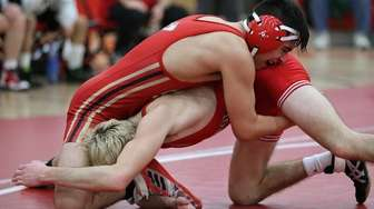 Sachem East's Ed Martines(top) wrestles Connetquot's Steven Wilkinson