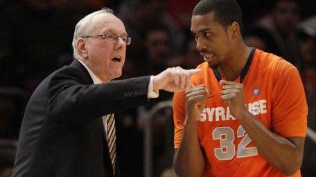 Syracuse coach Jim Boeheim, left, talks with Kris