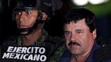 """Joaquín """"El Chapo"""" Guzmán, right, is escorted by"""
