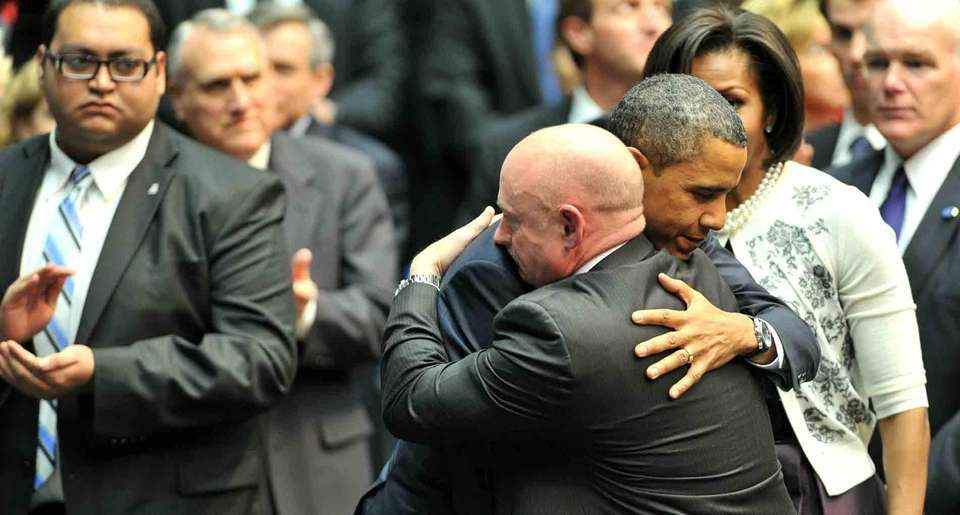 President Barack Obama hugs NASA astronaut Mark Kelly,