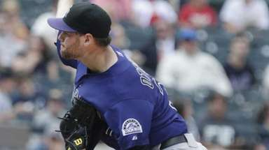Rockies relief pitcher Adam Ottavino delivers a pitch