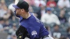 Rockies relief pitcher Adam Ottavino delivers a pitch