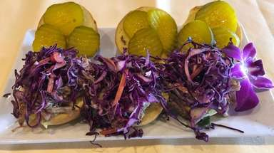 Pulled pork sliders are among the appetizers at