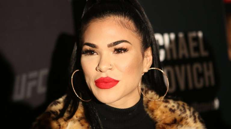 Flyweight fighter Rachael Ostovich speaks to reporters at