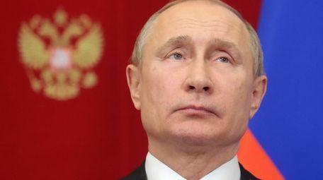 Russian President Vladimir Putin attends a signing ceremony