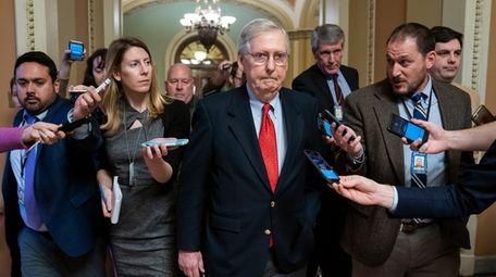 Reporters trail Republican Senate Majority Leader Mitch McConnell
