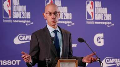 NBA commissioner Adam Silver gestures during a news