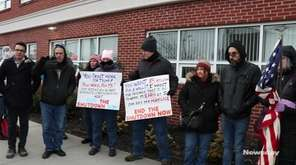 Protesters rallied outside Rep. Lee Zeldin's office in