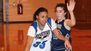 Copaigue's Melinda Harris carries the ball while being