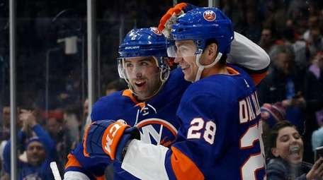 Michael Dal Colle of the Islanders, right, celebrates