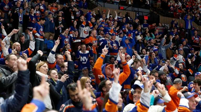 New York Islanders fans cheer after a first