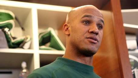 Jason Taylor talks to media after practice at
