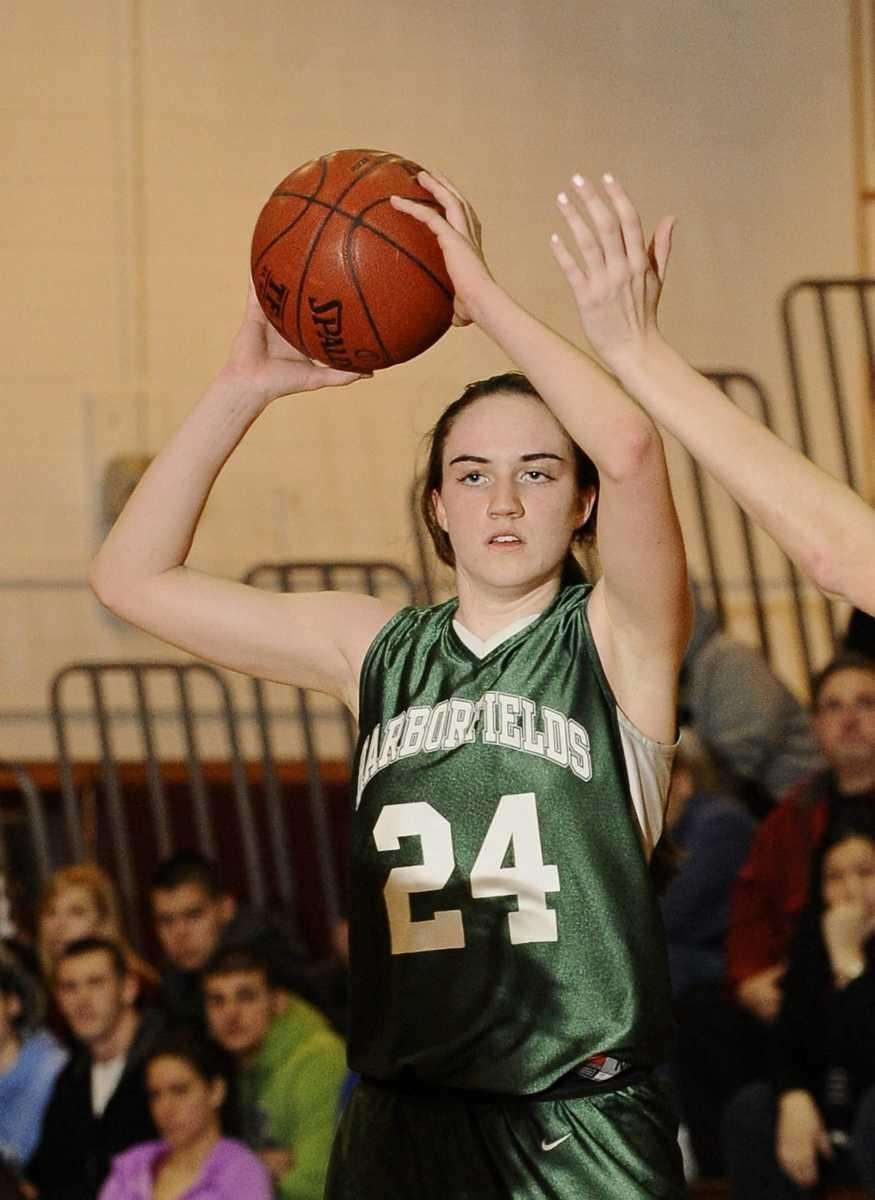 Harborfields' Bridgit Ryan looks to pass during her