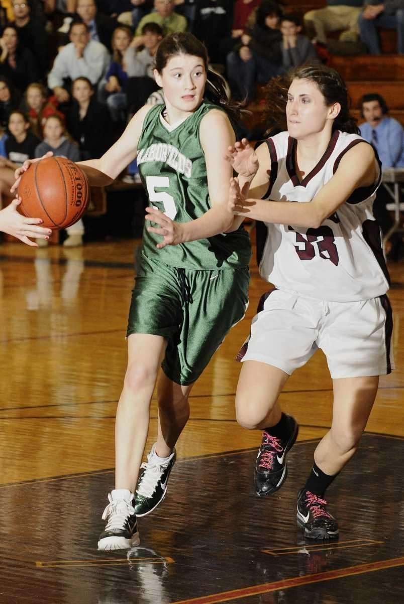 Harborfields' Alexia O'Connor drives the ball past Kings