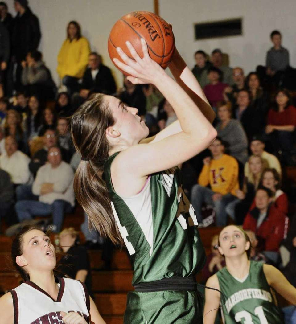 Harborfields' Bridgit Ryan goes up for a basket