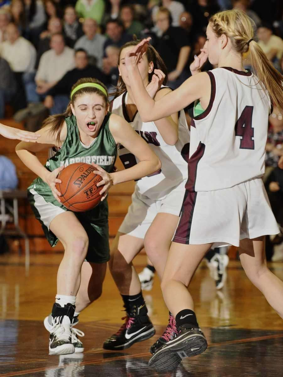 Harborfields' Kasey Stolba is guarded by Kings Park's
