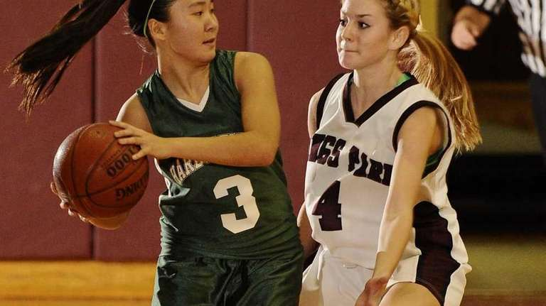 Harborfields' Lynn Zhong is guarded by Kings Park's