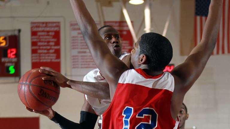 Hills West's Tavon Sledge (3) is fouled by