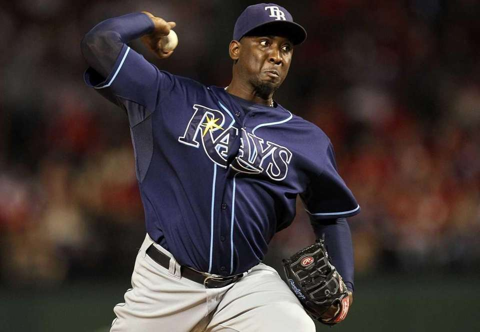 Tampa Bay pitcher Rafael Soriano throws against the