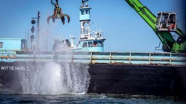 Construction material is dropped into the Smithtown Reef