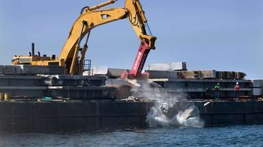 Tappan Zee Bridge material is dropped onto the
