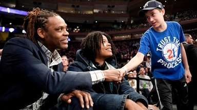 Latrell Sprewell, former Knicks guard, greets a fan