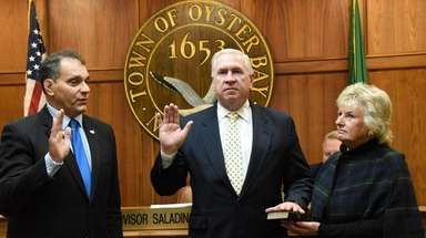 Oyster Bay inspector general Brian Noone, center, was
