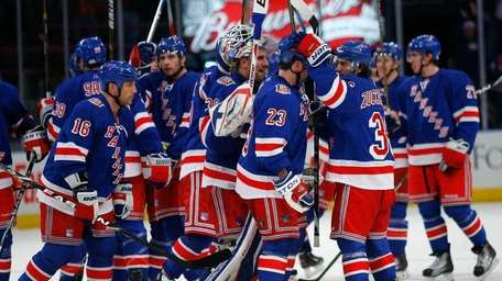 Rangers goaltender Henrik Lundqvist celebrates with his teammates