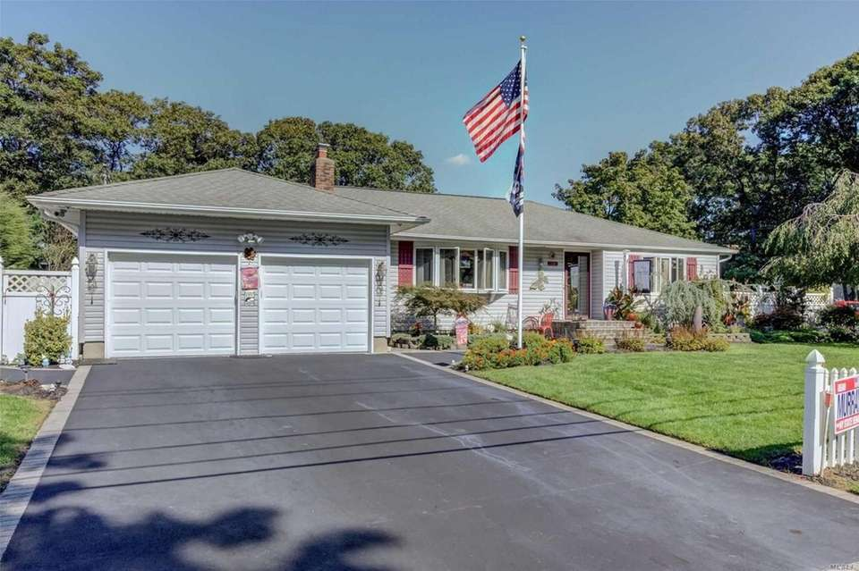 This Ronkonkoma ranch includes three bedrooms and two