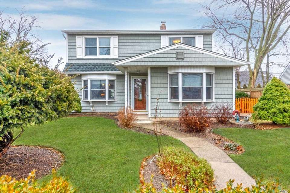 This Levittown Colonial includes four bedrooms and 1