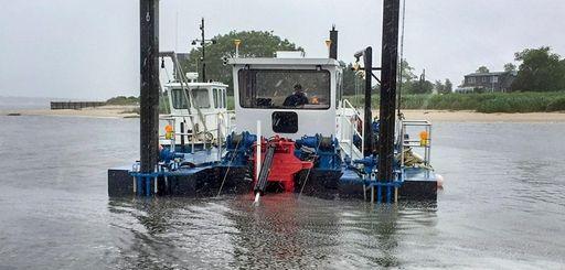 Dredging operations in June in East Creek, Town